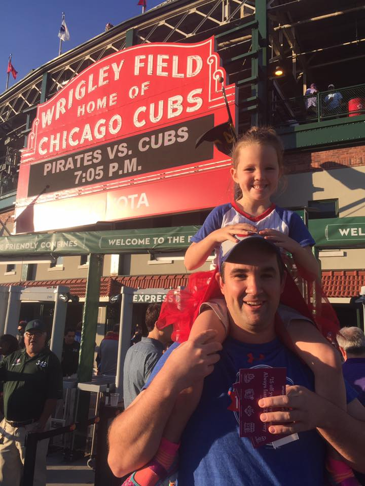 Joe Bruzdzinski Jr with his son at a Cubs game